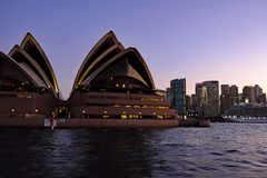The Sydney Opera House and Circular Quay, Sydney harbour, Australia, at Dusk Royalty Free Stock Photography