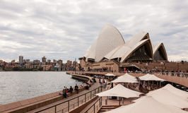 Sydney Opera House on a cloudy day. Sydney, Australia - July 11, 2010 : Sydney Opera House is a multi-venue performing arts centre also containing bars and stock images