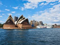 Sydney Opera House and Cruise Ship Docked in Circular Quay, Sydney, Australia. The Sydney Opera House and a large white modern cruise ship docked at the royalty free stock photography