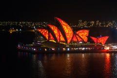 Sydney Opera House ed il ponte del porto al tramonto Fotografia Stock