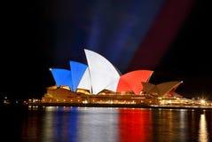 Sydney Opera House en colores de la bandera francesa Imagen de archivo libre de regalías