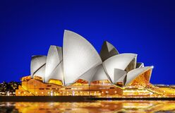 Sydney Opera House in the evening with clear blue sky