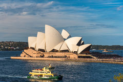 Sydney Opera House and ferry boat in Sydney Harbour Royalty Free Stock Image
