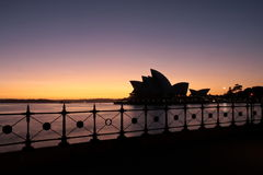 Sydney Opera House at first light. Silhouette of Sydney Opera House at first light Royalty Free Stock Photography