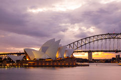 Sydney Opera House and the Harbour Bridge at dusk. Sydney, Australia - July 11, 2010; Sydney Opera House and the Harbour Bridge at dusk. Taken from Mrs stock images