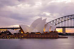 Sydney Opera House and the Harbour Bridge at dusk. Sydney, Australia - July 11, 2010; Sydney Opera House and the Harbour Bridge at dusk. Taken from Mrs royalty free stock photos