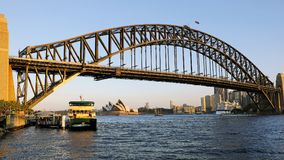 The Sydney Opera House and a Harbour Ferry at Sunset, Australia Royalty Free Stock Image