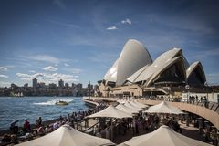 Sydney opera house and harbour promenade outdoor cafes in austra Stock Image