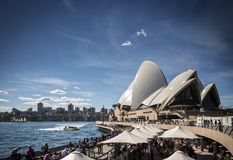 Sydney opera house and harbour promenade outdoor cafes in austra Royalty Free Stock Photo