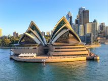Sydney Opera House in Harbour waterfront. Exterior of Sydney Opera House on Harbour waterfront in Australia on sunny day with blue skies Royalty Free Stock Photography