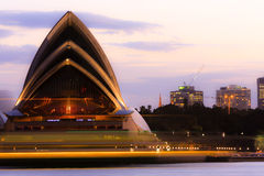 Sydney Opera House with light streaks. Sydney Opera House at dusk, with light streaks from passing ferries Stock Images