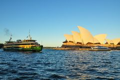 Sydney opera house, is a multi-venue performing arts centre with Green ferry boat in Sydney harbour. royalty free stock photography