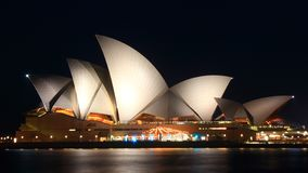 Sydney Opera House by Night. The Sydney Opera House is a multi-venue performing arts center in Sydney, New South Wales, Australia. It is one of the 20th century royalty free stock images