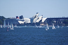 Sydney opera house with queen victoria cruise ship Royalty Free Stock Photography