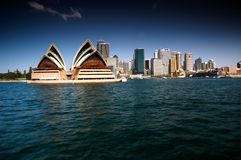 Sydney Opera House with Sydney CBD in Back Ground. Stock Photo of Opera House and Sydney CBD from Sydney Harbour featuring the city, circular quays, the rocks Stock Images