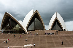 Sydney Opera House under cloudy skies. Sydney Opera House in Australia with the stairs in foreground Royalty Free Stock Photo