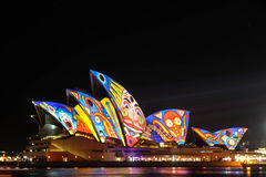 Sydney Opera House under festival designs. Sydney Opera House lit with designs from the Vivid Sydney Light Festival in 2013 Royalty Free Stock Image