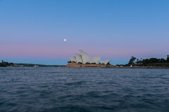 Sydney opera house  view with full moon at sunset. In Sydney,Australia.Oct 17,2016 Sydney Opera House is famous arts center. Over 10 millions tourists visit Royalty Free Stock Image