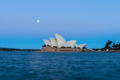 Sydney opera house  view with full moon at sunset. In Sydney,Australia.Oct 17,2016 Sydney Opera House is famous arts center. Over 10 millions tourists visit Royalty Free Stock Photos