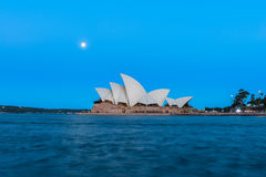 Sydney opera house  view with full moon at sunset. In Sydney,Australia.Oct 17,2016 Sydney Opera House is famous arts center. Over 10 millions tourists visit Stock Photo