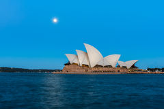 Sydney opera house  view with full moon at sunset. In Sydney,Australia.Oct 17,2016 Sydney Opera House is famous arts center. Over 10 millions tourists visit Stock Photos