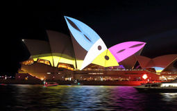 Sydney Opera House during Vivid Sydney with Toucans. SYDNEY, AUSTRALIA - MAY 23, 2015; Sydney Opera House illuminated with colourful animated imagery during the stock photo