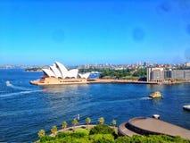 Sydney opera house water bridge lake ocean buildings city beautiful. From a walk over a bridge in Sydney Stock Photos
