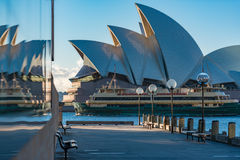 Sydney Opera House and wooden wharf on sunny day Royalty Free Stock Photos