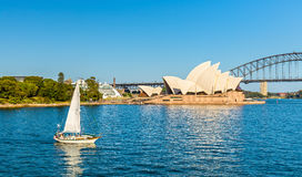 Sydney Opera House and a yacht in the Harbour - Australia Stock Photos