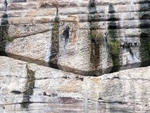 Sydney Sandstone Cliff and Retaining Wall, Australia. A massive Sydney sandstone cliff or retaining wall with roughly shaped sandstone blocks on top of a natural stock photography