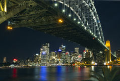 Sydney skyline and Harbour Bridge. At night Stock Photography
