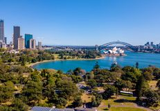 Sydney Skyline and Harbour Bridge. Aerial view on the Sydney harbour from above with city skyline, botanic garden, park and of course the Harbour bridge Stock Photos