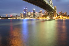 Sydney skyline with Harbour Bridge night scenery. Long exposure image of Sydney's skyline with the Harbour Bridge across. The colors of the city's Stock Photography