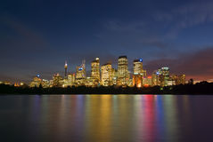 Sydney skyline at night. Colorful illumination reflected in the water Royalty Free Stock Photos