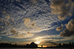 Sydney Skyline Sunset. With opera house and harbour bridge silouette Royalty Free Stock Image