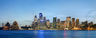 Sydney skyline after sunset. As viewed south across the harbour from Kirribilli Stock Photos