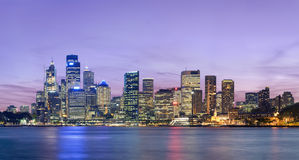 Sydney skyline after sunset. As viewed south across the harbour from Kirribilli Stock Image