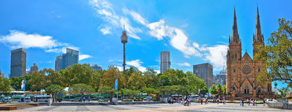 Sydney skyline with Sydney Tower and St Mary's Cathedral in Sydney. Sydney, Australia - January 23, 2015: View of Sydney skyline with Sydney Tower and St Mary's Stock Photos