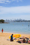 Sydney skyline from Watson Bay. Sydney centre skyline scenery with Sydney Tower, harbour and other downtown buildings. View from Watson Bay sandy beach with few Stock Photos