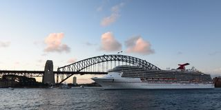 Cruise ship passing by the Harbour Bridge. Sydney. New South Wales. Australia. Sydney is the state capital of New South Wales and the most populous city in stock image