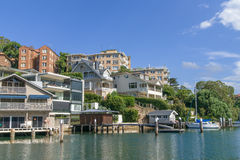 Sydney suburban docks. Yachts and docks at marina, with expensive houses in affluent suburb of Mosman Bay, Sydney, New South Wales, Australia Stock Photos