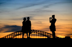Sydney Tourists. Taking photos at sunset in front of Sydney Harbour Bridge Stock Images