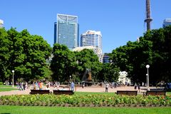 Sydney Tower and City Buildings, View From Hyde Park, Australia. View of Hyde Park with the Archibald Fountain, to the Sydney central business district skyline Stock Images