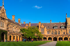 Sydney Uni inner yard with students in the distance enjoying bre Royalty Free Stock Image