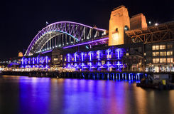 Sydney Vivid Bridge Rocks. Australia Vivid Sydney lights and projection show night view on the illuminated colourful bridge side from the Rocks Royalty Free Stock Photography