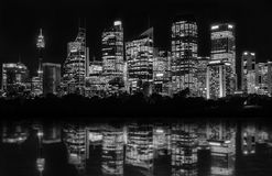Sydney Waterfront at Night. Beautiful Sydney Waterfront at night of Central Business District seen from Farm Cove, with reflections in bay`s water Stock Images