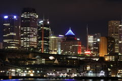 Sydney wharf and skyline at night Stock Photos