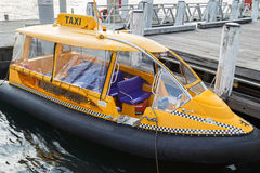Sydney Yellow Water taxi docking at the pier at Darling Harbour Royalty Free Stock Photo