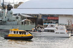 Sydney Yellow Water taxi passing yacht, Destroyer HMAS Vampire s Stock Photos