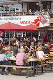 Sylt. List, Germany - August, 8th 2009:: Famous restaurant called Gosch in List, Sylt, Germany. Tourists sitting outside the restaurant and enjoy a nice summer royalty free stock photography